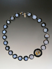 """This very popular design features subtle natural gray agate discs with natural black trim spaced with jet Swarovski crystals feature a matte onyx donut centered with a silver periwinkle Venetian glass disc.  Onyx sterling clasp 19"""" Choose rectangles or oval beads as available."""
