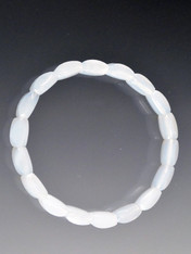 A delicate pale chalcedony bracelet circles your wrist makiing a subtle statement - or stack with others.  7""