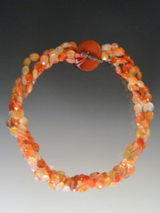 This beautiful necklace features multi-strand faceted carnelian with a carnelian donut and toggle clasp.  The matching bracelet with the same design can be fastened to make one long necklace.  20""