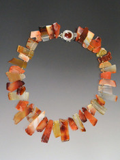 Beautiful shards of carnelian in every shade spaced with 14K rondels and a garnet sterling clasp make a beautiful asymmetrical collar for any occasion and any outfit. 18""