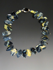 It is extraordinarily rare to find naturally occurring yellow and black opal in the same strain.  Years ago I bought this strand of amazing two toned opal in large faceted nuggets. This season I made a super dramatic necklace with smaller yellow opal rondels mixed in and a large onyx sterling clasp. 20""