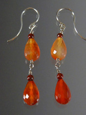 Striking dangle earrings in top quality faceted carnelian citrine teardrops and sterling earwire.  Perfect match to necklace in the collection. 1.3/4""