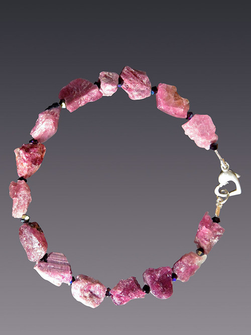 "Mix this stunning natural pink tourmaline faceted garnet bracelet with others for a dramatic stacked look.  Sterling clasp. 7.5""."