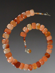 For the person who wants to make an understated, expensive statement, this delicate, superb quality carnelian collar features perfectly matched faceted multi-shade carnelian.  18""