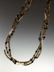 """All out Deco Drama! A glittering 64"""" strand of14K curved beads,"""