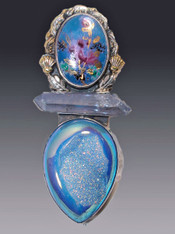 "This dramatic Amy khan Russell pin/pendant features an intricate cloisonné enamel cabochon with a richly embellished brass accented frame, a faceted iridescent quartz bar and Brazilian Druzy all bezel set in Sterling Silver with brass accents.  Most unusual!  3"" x 2"""
