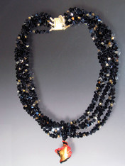 Luxuriate in six strands of Grade AAA onyx's dice spaced with 24K Swarovski crystals with 24K brushed goldplated clasp.  A dramatic Venetian glass swirl centerpiece suspended from a circle of onyx beads can be removed for an elegant torsade look. 18""