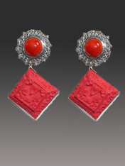 "RETAIL PRICE: $398..... SALE $148 These Amy Kahn Russell earrings are perfect for right now and add glamour and interest with a two stone dangle.  The top features a red coral cabochon with an elaborate silver frame and the bottom features a hand-carved cinnebar dangle. These earrings that will go with everything.   2"" x  2""   Now  clips; can be converted to posts for an additional $15."