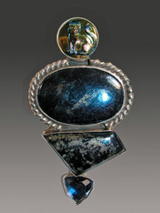 "If you love a substantial antique look, this is the pin/pendant for you. This goreous Amy Kahn Russell design features a rare button with a delightful cat atop a large asymmetric covelite and a faceted deep blue quartz cabochon bezel set in sterling silver. Just like the good old luxurious Amy pins.  3-1/4"" x 2"""