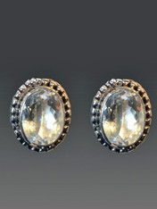 "These simple sparkling Amy Kahn Russell earrings shine like diamonds and can be dressed up or down.  They feature crystal clear faceted white topaz bezel set in an intricately patterned sterling silver frame . 3/4"" x 1/2"" Now posts. Convert to clips for $15."