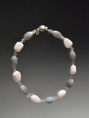 """This delicious collar features Grade AAA pale pink Brazilian opal, matte and shiny patterned hexagon shaped gray moonstone, and tiny complementary Swarovski crystals. Dress up or wear every day. 18"""""""