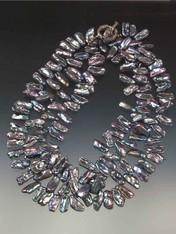 """An opulent 42"""" rope of lustrous iridescent peacock biwa pearls."""