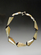 """Thiscollar features unusual hexagon shaped luminous mocha shells with deep brown tips forming a fascinating circle around your neck. 19"""""""