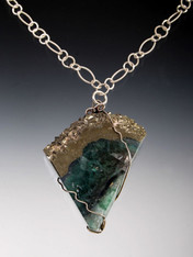 """Stunning fluorite slice radiates deep green and purple with a natural band of rich pyrite (known as fool's gold). 20"""""""