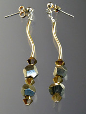 These glittering earrings feature alternating silver pyrite and 24K Swarovski crystals!