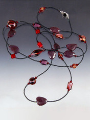 """A Luxury  Bestseller! This vibrant rope of raw ruby slices, 24K ruby/garnet Venetian glass and garnet sterling clasp lets you double or triple with ease. Choose 42"""" or 64"""". These specially shaped and intensely colored Venetian glass beads were custom ordered from Italy, the faceted ruby slices custom ordered from the finest gem centers in India.Cannot be reordered - supplies limited"""