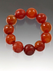 "Rare and special grade AAA carnelian 16mm perfect round beads traditionally worn by men in China for ""good luck"". This gleaming dramatic stretch bracelet with oversize stones is just right for today's bold looks and colors and for any man or woman who wants ""good luck""  Very Limited!"