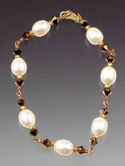 "A delicate hand-wrapped gold wire bracelet of white freshwater pearls and Swarovski crystals, 24K vermeil clasp.  Available in 7"", 7-1/2"", or 8"" Matching necklace, rope, and earrings available."
