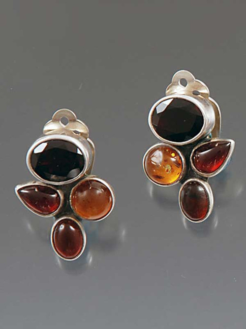 "These Amy Kahn Russell earrings feature rich faceted garnet, amber and tourmaline cabochons bezel set in sterling silver. 1"" x 3/4"""