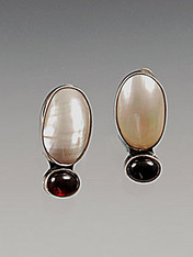 """A luminous mabe pearl rests atop a deep garnet cabachon all hand-set in sterling silver. 1-1/4 x 1/2"""" Now clips; convert to posts for an additional $12"""