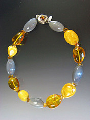 """About 20 years ago I found a strand of huge precious baltic amber beads and now I've used them in this magnificent collar mixed with grey hexagon shaped moonstones and grade AAA faceted citrine. This beautiful necklace features a vintage amber sterling clasp with safety hinge. 19-1/2"""""""