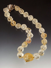 This one of-a-kind necklace features rare, beautiful hammered Brazilian citrine glowing in pale gold to deep gold orbs--hand-knotted with gold silk thread--with a large center stone and custom mabe pearl clasp.  17""