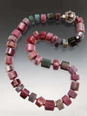 """SO RARE AND SO FABULOUS! This strand of grade AAA trillion cut Brazilian strawberry tourmaline features amazing colors, Japanese double hand-knots in silk and a custom mabe pearl sterling clasp. 18"""""""