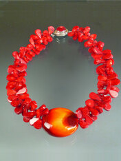 """If you want to make a WOW dramatic statement, this dazzling creation is for you. Huge tomato red coral florets frame a one of a kind 2-1/2"""" glazed Venetian Glass Disc (snagged at a trade show many years ago waiting for the right opportunity and setting) with a sunburst pattern of deep red, orange and gold . A red coral sterling 1"""" custom clasp completes the design. Picture this on bright white, black, or the new bold tones of the season. Total length 22"""""""