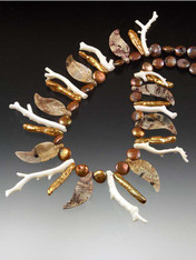 """This dramatic collar features jasper hand-carved leaves spaced with rare natural white branch coral and golden brown coin pearls. Stunning on the shore, in the mountains, at a resort, or in the """"urban jungle"""" all year round. 18"""""""