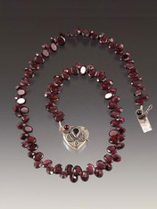 "Have a heart---in this case a 17"" Grade AA sparkling rhodolite garnet necklace centered with a vintage sterling garnet heart clasp."