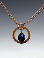 Make a double impact with this delicate yet bold grade AAA faceted lapis teardrop ramed with a 24K ULTRAPLATE* hoop and chain  18""