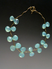 Flowering vines of grade AAA aqua chalcedony clusters are suspended between 14K curved branches and a 14K toggle clasp. 18""