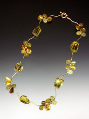 """Like a delicate green-gold vine, this charming 17"""" collar of perfect lemon topaz stones is spaced with 14K branches and precious clusters of green garnet, peridot and gold petal pearls with a 14K toggle clasp. NOTE: Can be special ordered with less karat weight for lower price. inquire by email."""