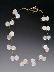 This delicate collar features grade AAA natural chalcedony with 14K vine tubes and a 14K toggle clasp