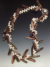 """About six years ago I discovered several strands of bronze biwa pearls that were drilled at an unusual angle either intentionally or accidentally. When entwined with tiny white freshwater pearls the effect is exactly like twigs with sprigs of white blossoms. Held with a vintage mabe pearl sterling clasp. You'll never see this again. Only three! 17"""""""