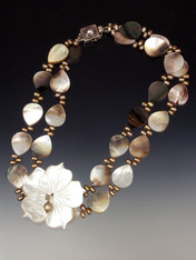 "A website bestseller!  This creamy mocha mother-of-pearl and champagne freshwater pearl collar features a 2"" x 2"" carved  white mother-of pearl flower. Whether fair or dark, you'll be amazed at how it flatters your complexion and complements your wardrobe in every season. 20"""