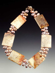 "Fascinating to see in person and flattering to wear!  An 18"" collar of fossilized coral rectangles -- each with intricate patterns formed over many years-- framed by lustrous blush-toned freshwater pearls.  Each piece unique!"
