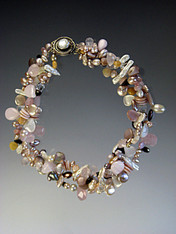 """A delightful torsade of tiny sparkling pink opal, multi-toned and shaped freshwater pearl teardrops, and Swarovski crystals. No two alike but all fabulous. Choose one, two or three strands for a spectacular showpiece. One strand 18"""" Two and Three Strands 21"""""""