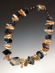 """A huge faceted Brazilian topaz is the dramatic focal point for a stunning collar of Grade AAA rare South African Pietersite (filled with natural patterns of black, blue, gray, and brown) spaced w champagne biwa pearls and 14. 17"""" ONLY TWO!"""
