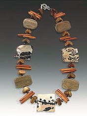 His geometric mix of all natural elements makes a sophisticated modern statement!