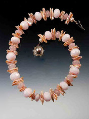 This intricate collar is a medley of pink pastels featuring Grade AAA pale pink Brazilian opal, rose quartz, and shiny biwa pearls with a custom mabe pearl sterling clasp. 18""