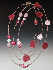 A whimsical medley of rhodonite slices, raspberry and white Venetian glass and Swarovski crystals.