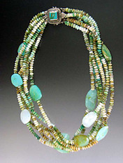 """This stunning torsade features six strands of multi-toned Peruvian opal rondels spaced with Peruvian Opal faceted slices and a custom clasp of turquoise set in a patterned sterling silver clasp with two safety catches. 18"""" flat."""