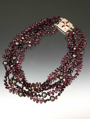 """Take center stage with a magnificent multi-strand sparkler of grade AAA faceted rhodolite garnets starring 12mm freshwater pearls, finished off with a custom sterling garnet clasp. Available in 5 or 6 strands 20"""" Similar design sold in high end Madison Avenue Boutique for $30,000 (with gold clasp)"""
