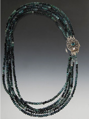"""Absolutely dazzling!  Five strands of grade AA tiny faceted green tourmaline with alternating bands of color held by a dramatic sterling appatite clasp for a center or side focal point.  Note: the strands are perfectly nesting but can also be slightly twisted as in this picture.  20"""""""