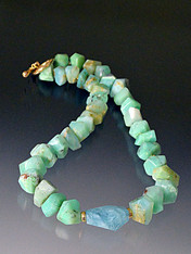 """Brilliant grade AA cut Peruvian opals with natural variations, a faceted Brazilian aquamarine center stone, 14K rondels and clasp  18"""""""