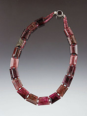 A spectacular collar of grade AA trillion cut perfectly matched pieces of Brazilian watermelon tourmaline in dazzling shades of pinks, rubies and green