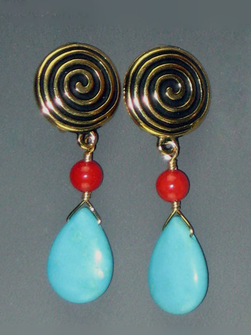 Our most popular clip earring features Terracast 22K plate swirl discs with faceted coral and and turquoise teardrop dangles. They go with everything and are super light and comfortable 1-1/4""