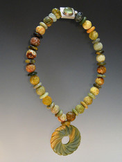 """If you like jade,you'll love this all jade necklace featuring carved jade beads, a swirl jade pendant,and a custom Peruvian prehnite sterling clasp 19"""""""