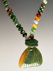 """A dramatic multi-toned jade pendant hangs from a brilliantly colored jasper chain. 19"""""""